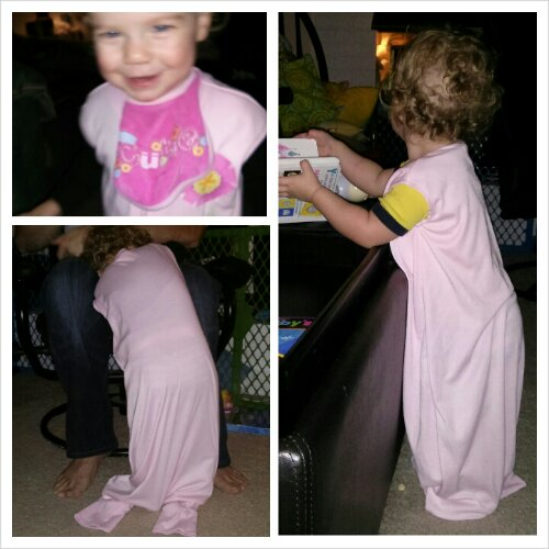 Lucy was feeling camera shy while modelling her SleepSack, but look at those curls she's growing!